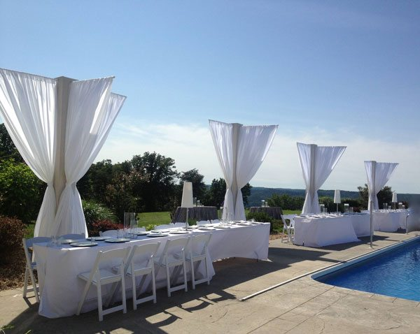 Fabric added the wow factor to this poolside wedding reception in Jamestown, Tenn.